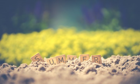 """""""Summer"""" Written Out in Scrabble Tiles in the Sand"""